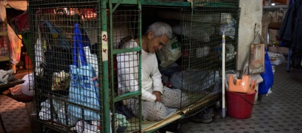 "Hong Kong man sits in 8x4 foot ""cage home""."